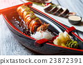 Shrimp on sushi boat. 23872391