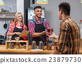 Barista serving client give glass tea coffee shop 23879730