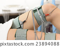 Beautiful Woman getting Electrostimulation Therapy 23894088