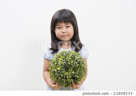 Girls with spherical fake green 23898533