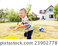 Little boy with water gun splashing somebody 23902778