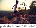 young asian woman runner running on mountain peak 23905845