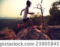 young asian woman runner running on mountain peak 23905845