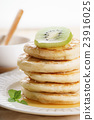 pancakes with honey syrup and fresh kiwi sliced 23916025