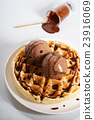 waffles with chocolate ice cream and sauce 23916069