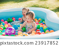 The two little baby girls playing with toys in 23917852