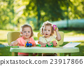 The two little baby girls playing toys in sand 23917866