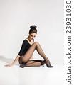 Beautiful woman in hosiery sitting on the floor 23931030