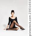 Beautiful woman in hosiery sitting on the floor 23931033