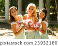 The smilling bridesmaids with bouquet 23932160