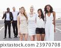 Well dressed people posing 23970708