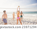 Friends playing beach volleyball 23971294