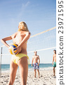 Friends playing beach volleyball 23971595