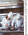 Chefs decorating a cake 23971855