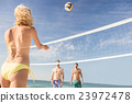 Friends playing beach volleyball 23972478