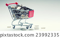Shopping trolley full of euro money-coins-currency 23992335