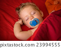 Infant boy sleeping with soother 23994555