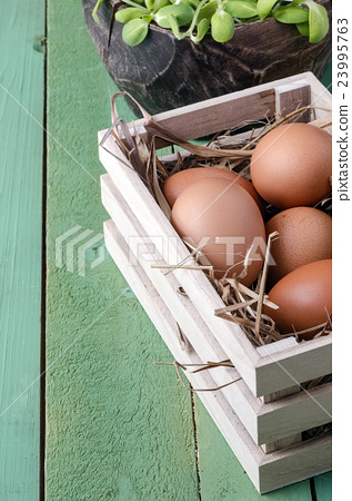 eggs in wooden box,eggs of hen in nature. 23995763