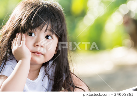 cute asian baby smiling in garden stock photo 24005863