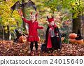 Kids on Halloween trick or treat 24015649