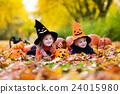 Kids with pumpkins on Halloween 24015980