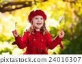 Little girl in autumn park 24016307