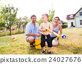 Boy with mother and father after splashing each 24027676