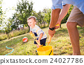 Little boy with father playing with water guns 24027786