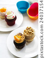Colorful delicious cupcakes on plates 24037154