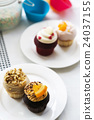 Colorful delicious cupcakes on plates 24037155