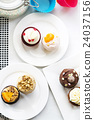 Colorful delicious cupcakes on plates,top view 24037156