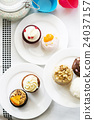 Colorful delicious cupcakes on plates,top view 24037157