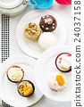 Colorful delicious cupcakes on plates,top view 24037158