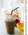 Ice coffee with milk foam on table 24037160