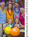 Portrait of smiling multi generation family celebrating birthday  24053501