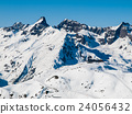 Sunny winter day in alpine ski resort 24056432