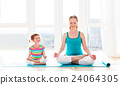 family mother and child daughter are engaged in meditation and y 24064305
