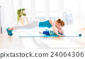 sports mother is engaged in fitness and yoga with baby at home 24064306