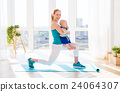sports mother is engaged in fitness and yoga with baby at home 24064307