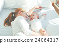 happy family mother  with baby playing and hug in bed 24064317