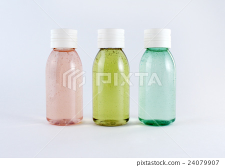 Three plastic bottles with colored liquids  24079907