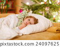 Little cute kid boy sleeping under Christmas tree 24097625
