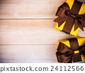 Composition of packed gift boxes on wooden board 24112566