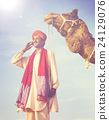 Indian Man On the Phone Camel Communication Concept 24129076