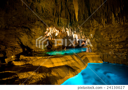 Cave with many stalactites and lake 24130027