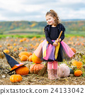 little girl wearing halloween witch costume on 24133042