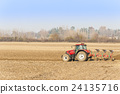 Red Tractor Plowing in Autumn. 24135716