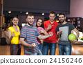 Friends having fun in bowling 24156246