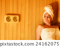 woman relaxing in wooden sauna room 24162075