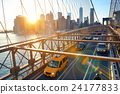 Brooklyn Bridge with traffic at sunset 24177833